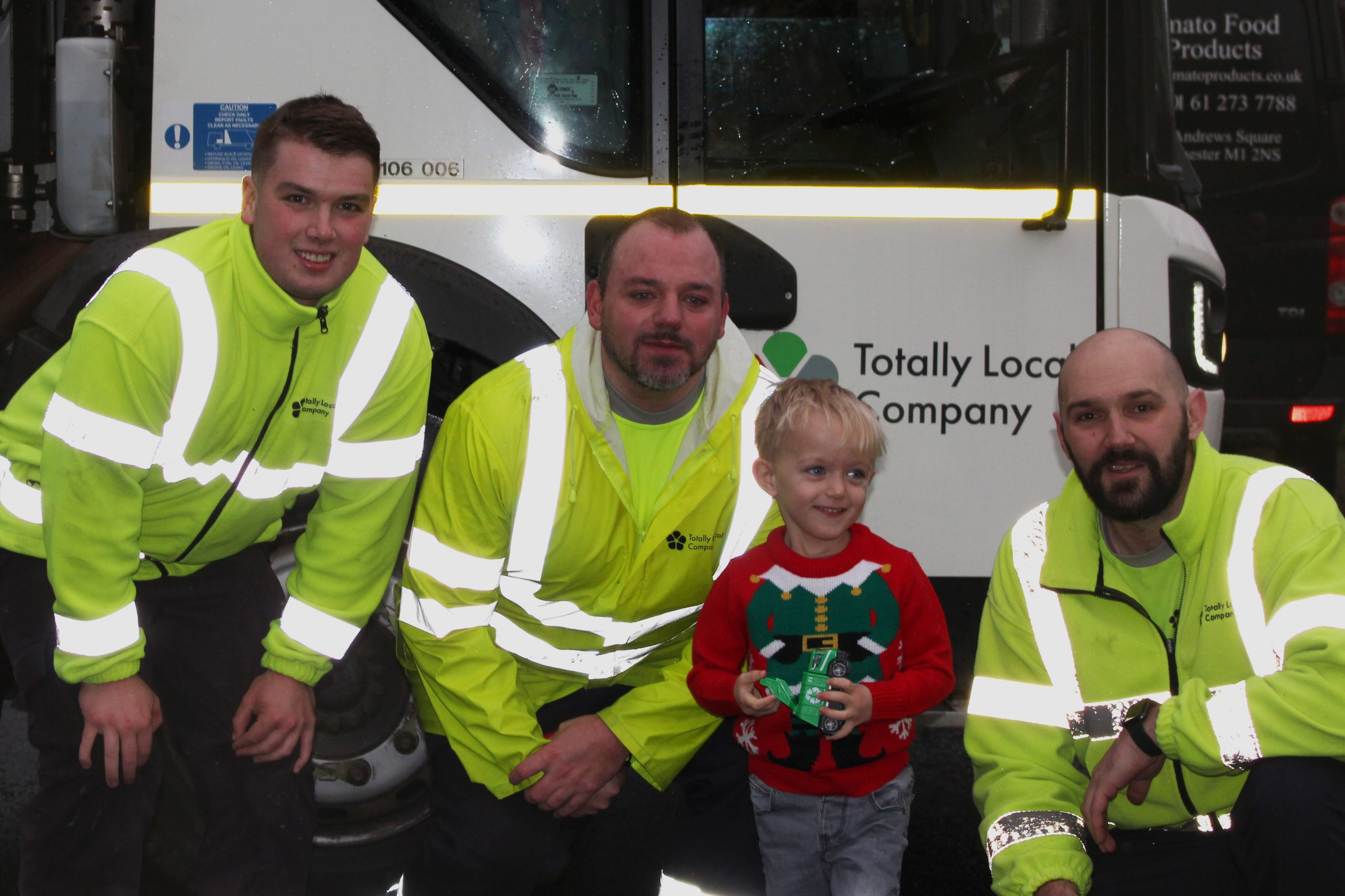 waste collectors with little boy
